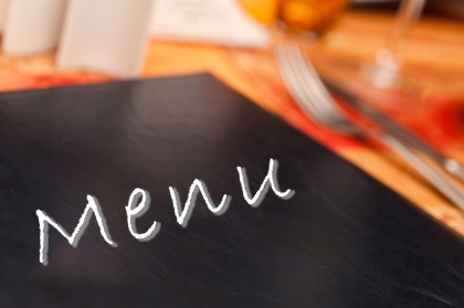 Menu & Cutlery on A Restaurant Table